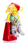 Toy lion as christmas gift on Santa Claus cap — Stock Photo