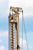 Auger part over blue sky with clouds — Stock Photo