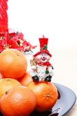 Pile of tangerines, Snowman, christmas decoration — Stock Photo