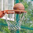 Basketball hoop on a backboard and ball - Stock Photo