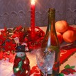 New Year's setting with wine, glass, tangerines, christmas decor — Stock Photo #4805843