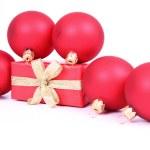 Christmas balls and a gift — Stock Photo #4218129