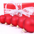 Christmas balls and a gift — Stock Photo #4218731