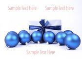 Christmas balls and a gift — Stock Photo