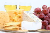 Cheese, wine and crackers — Stock Photo