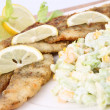 Fried fish with side salad - Stock Photo