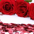 Red roses and confetti — Stock Photo #4793997