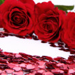 Red roses and confetti — Stock Photo