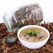 Stock Photo: Mushroom soup and dried mushrooms