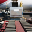 Loading cargo plane - Stock Photo