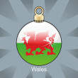 Wales flag in christmas bulb shape — Stock Vector
