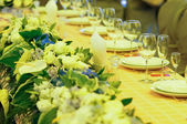 Banquet table with flowers — Stock Photo