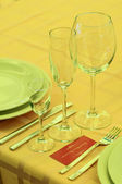 Wineglasses with name card — Stock Photo