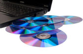 Laptop with many disks — Stock Photo