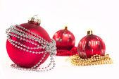 Three red Christmas balls — Stock Photo