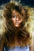 Portrait of the girl with a mad hairdress — Stock Photo