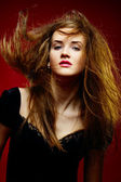 Portrait of the beautiful girl a wild hair — Stock Photo