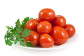 Pickled red tomatoes with green parsley — Stock Photo