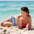 Woman in a colorful dresst on the beach — Stock Photo