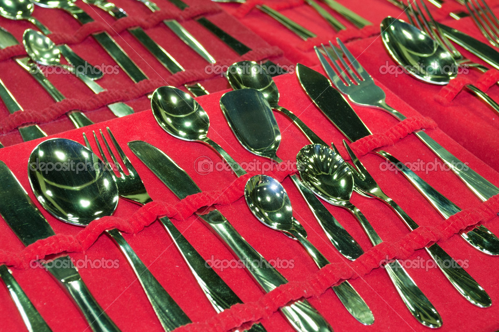 Set of cutlery in stainless steel on a red velvet  Stock Photo #4353375