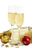 Two glasses of champagne with angels hair, red and golden christmas balls i — Stock Photo