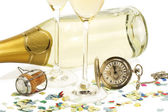 Two glasses with champagne, old pocket watch, cork and confetti in front of — Stock Photo