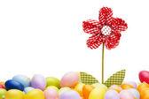 Red drapery flower between easter eggs — Stock Photo