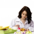 Young woman at breakfast eating corn flakes — Stock Photo