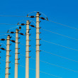 High-voltage pole against a blue sky — Lizenzfreies Foto