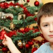 Young boy holding Christmas decorations — Stock Photo