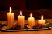 Christmas decorated table with lighting candles — Foto Stock
