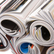 Rolled up magazines isolaten on white — Stock Photo