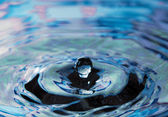 Dark blue water and water bubbles in blue — Stock Photo