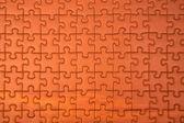 Puzzle in orange — Stock Photo