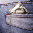 Condom in the pocket of a blue jeans — Stock Photo