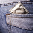 Stock Photo: Condom in the pocket of a blue jeans