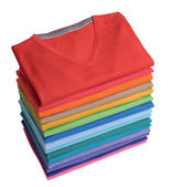 Pile of colorful t-shirts freshly folded from the laundry — Stock Photo