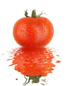 Fresh tomato with drops and refletion on water smooth surface — Stock Photo