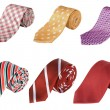 Business ties rolled up over white background — Stock Photo