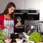 Pretty woman stirring in the pan — Stock Photo
