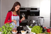 Pretty woman stirring in the pan — Stock Photo
