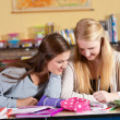 Two schoolgirls in class — Stock Photo