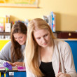 Two girls in the classroom — Stock Photo #4097580