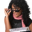 Peering over her sunglasses — Stock Photo