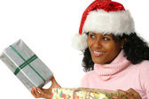 Beautiful brazilian girl with christmas presents — Stock Photo