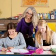 Teacher checking on her students — Stock Photo