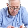 Senior man and mobile — Stock Photo