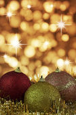 Red,yellow and gold Cristmas Baubles — Stock Photo