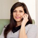 Beautiful woman talking on the pfone — Stock Photo