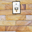 Buzzer switch on brick wall — Stockfoto